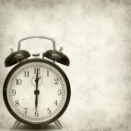 22480590-old-fashioned-alarm-clock-Stock-Photo-antique