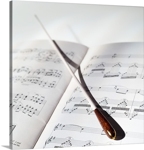 a-conductors-baton-lying-on-sheet-music,1000314